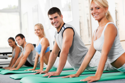 Group of cheerful people doing exercises on the exercising mat.   [url=http://www.istockphoto.com/search/lightbox/9786738][img]http://dl.dropbox.com/u/40117171/group.jpg[/img][/url]  [url=http://www.istockphoto.com/search/lightbox/9786766][img]http://dl.dropbox.com/u/40117171/sport.jpg[/img][/url]